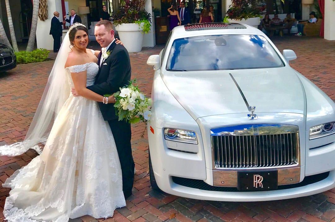 Couple Outside White Rolls Royce